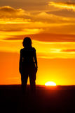 Silhouette of a woman at sunset Royalty Free Stock Photo