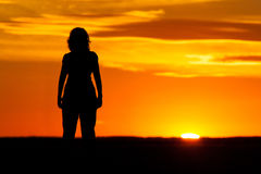 Silhouette of a woman at sunset Stock Photography