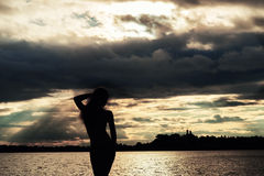 Silhouette woman at sunset on the beach Royalty Free Stock Image