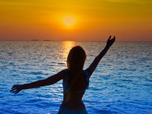 Silhouette of the woman .sunset in the sea Stock Photography