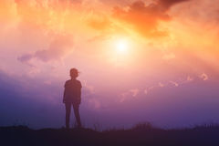 Silhouette of woman and sunset time Royalty Free Stock Photos