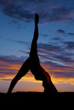 Silhouette woman swimsuit one leg up one down Stock Photo