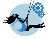 Silhouette of a woman on a swing Royalty Free Stock Photography