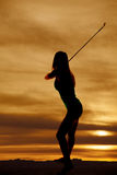 Silhouette woman swinging club Royalty Free Stock Photos