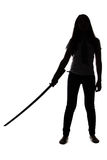 Silhouette of woman with sword Stock Images