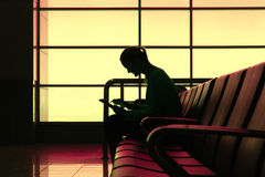 Silhouette of woman with tablet pc in the airport Royalty Free Stock Photography
