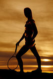Silhouette woman tennis racquet down Stock Photo