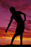Silhouette of a woman in tight dress lean to side Stock Photo