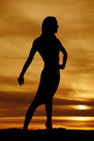 Silhouette of a woman in tight dress pose Royalty Free Stock Image