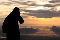 Silhouette woman on the top mountain in the morning Stock Photos