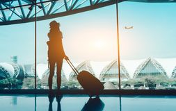 Silhouette woman travel with luggage stock photography