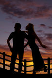 Silhouette woman try to kiss man Stock Photo