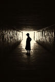 Silhouette of woman in a tunnel. Stock Photography