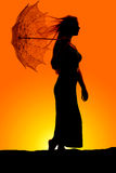 Silhouette woman umbrella hair blow Royalty Free Stock Photography