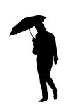 Silhouette of a woman with an umbrella Royalty Free Stock Photos