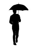Silhouette of a woman with an umbrella Stock Image