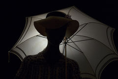 Silhouette woman with an umbrella. Stock Photography