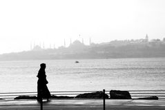 Silhouette of a woman walking. On the seaside Royalty Free Stock Photos