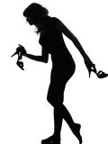 Silhouette woman walking quite barefoot on tiptoe Stock Photography