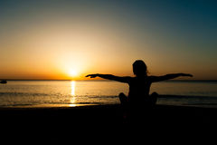 Silhouette of woman watching the sunrise Royalty Free Stock Image