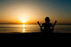 Silhouette of woman watching the sunrise Stock Photo