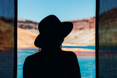 Silhouette of Woman Wearing Hat Near Sea during Daytime Royalty Free Stock Photo