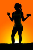 Silhouette of woman weights curl look side Stock Photo