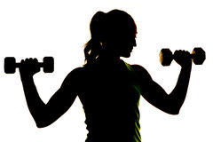 Silhouette of woman weights up close Stock Photo