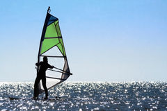 Silhouette of a woman windsurfer stock photography