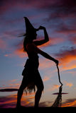Silhouette woman witch broom hold hat Stock Images