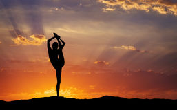 Silhouette of a woman Yoga in the evening. Royalty Free Stock Photo