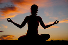 Silhouette woman yoga front sit Stock Photos