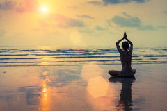 Silhouette of a woman yoga on sea sunset. Nature. Royalty Free Stock Images
