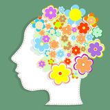 Silhouette womans head filled with cute flowers. Silhouette of a womans head filled with cute flowers Stock Photos