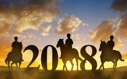 Silhouette of a womans riding a horse at sunset. Forward to the New Year 2018 Royalty Free Stock Image