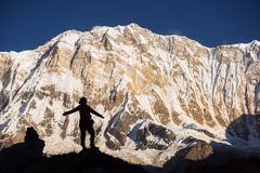 Silhouette women backpacker on the rock and Annapurna I Background 8,091m from Annapurna Basecamp ,Nepal. Royalty Free Stock Photos