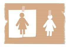 Silhouette of women cut out from paper on cardboard Royalty Free Stock Photo