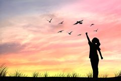 Silhouette women and dove birds Stock Images