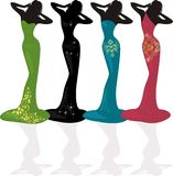 Silhouette of women in dresses Stock Photography