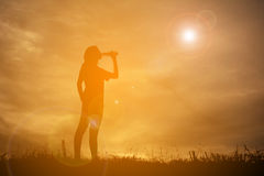 Silhouette women drinking water Royalty Free Stock Photos