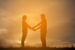 Silhouette women and man of lovers Stock Photo
