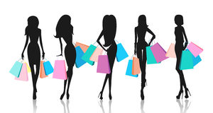 Silhouette of women with shopping bags Stock Photos