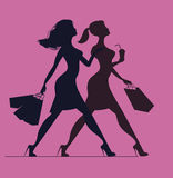 Silhouette of women with shopping bags. Silhouette of women on a Royalty Free Stock Photography