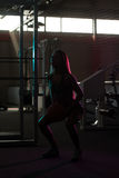 Silhouette Women Standing Strong In The Gym And Flexing Muscles Stock Images