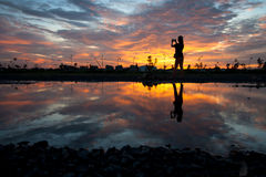 Silhouette women at sunset Royalty Free Stock Image