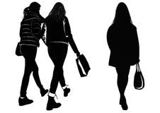 Silhouette of women walking with shopping bags Royalty Free Stock Photos