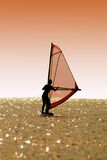 Silhouette a women on a windsurf. On waves stock photos