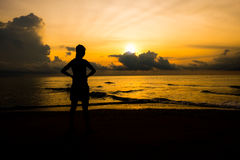 Silhouette of women. Silhouette of young sport women looking up sunrise or sunset at the beach that meaning the power of life and positive thinking royalty free stock photos