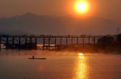 Silhouette of the wooden bridge . Stock Photo