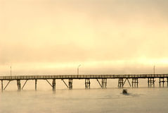Silhouette of the wooden bridge in the mist. Stock Photo